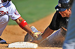 12 March 2011: New York Yankees' outfielder Austin Krum slides safely back to first during a Spring Training game against the Washington Nationals at Space Coast Stadium in Viera, Florida. The Nationals edged out the Yankees 6-5 in Grapefruit League action. Mandatory Credit: Ed Wolfstein Photo