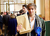 Ed Miliband <br /> leader of the Labour Party <br /> speech at RIBA Royal Institute of British Architecture, London, Great Britain <br /> 29th April 2015 <br /> General Election Campaign 2015 <br /> <br /> <br /> Labour activists holding 'The Tories' Secret Plan' brown envelopes being handed to delegates and press <br /> <br /> Photograph by Elliott Franks <br /> Image licensed to Elliott Franks Photography Services