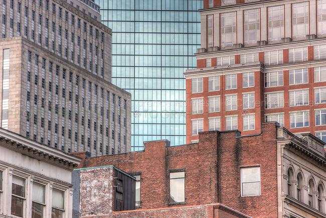 Contrasting facades of the John Hancock building and surrounding buildings, Boston, Massachusetts.
