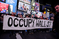 Protesters affiliated with the Occupy Wall Street movement take part in a protest called Occupy 2.0 as they marking the 3th Month aniversary in Times Square New York, United States. 02/12/2011.  Photo by Kena Betancur / VIEWpress.