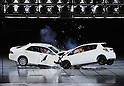 "July 21st, 2011, Susonosi, Japan - A Toyota Crown, left, collides head on with a Toyota VITZ at the speed of 55km/h (about 34 miles/h) in a demonstration at Toyotas Higashi-Fuji Technical Center on the foot of Mt. Fuji, some 92km (about 57 miles) southwest of Tokyo, on Thursday, July 21, 2011. Toyota showed to reporters technologies aimed at increasing safety for pedestrians and elderly drivers, as part of its initiatives to eliminate traffic casualties. The technologies include a Pre-Collision System with collision-avoidance assist, glare-preventing adaptive driving beams and a pop-up hood for lessening pedestrian injury. In the PCS, Toyota uses cameras and a super sensitive radar called ""millimeter-wave,"" both installed in the front of the vehicle, to detect possible crashes such as a pedestrian crossing the road. Then the vehicle calculates how braking and steering must be applied to avoid a crash. (Photo by Natsuki Sakai/AFLO) [3615] -mis-"