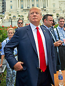 Donald Trump, a candidate for the 2016 Republican nomination for President of the United States, arrives at a rally against the Iran Nuclear Deal on the West Lawn of the US Capitol in Washington, DC on Wednesday, September 9, 2015.<br /> Credit: Ron Sachs / CNP<br /> (RESTRICTION: NO New York or New Jersey Newspapers or newspapers within a 75 mile radius of New York City)