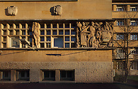 Main entrance with pillars by Pierre Meauze, 1913-1978, and reliefs by Anna Quinquaud, 1890-1984, Residence Lucien Paye, designed by Jean Vernon, Bruno Philippe and Albert Laprade, 1883-1978, and inaugurated 1949, in the Cite Internationale Universitaire de Paris, in the 14th arrondissement of Paris, France. Originally the Overseas French Territories House, the building was later used to house students from Sub-Saharan African countries. Pierre Meauze sculpted the pillars at the entrance and Anna Quinquaud made the bas-reliefs on the facade. The CIUP or Cite U was founded in 1925 after the First World War by Andre Honnorat and Emile Deutsch de la Meurthe to create a place of cooperation and peace amongst students and researchers from around the world. It consists of 5,800 rooms in 40 residences, accepting another 12,000 student residents each year. Picture by Manuel Cohen. L'autorisation de reproduire cette œuvre doit etre demandee aupres de l'ADAGP/Permission to reproduce this work of art must be obtained from DACS.