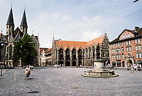Braunschweig: Alstadtmarkt--ensemble. From left, St. Martin's, 13th C.; Town Hall 13-15 C.; lead fountain with 3 basins in center. Fountain erected 1408, destroyed 1944, restored 1951. Photo '87.