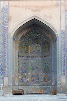 """Detail of niche in courtyard, Sher-Dor Madrasah, 1619-36, Registan, Samarkand, Uzbekistan, pictured on July 15, 2010, in the afternoon. The Sher-Dor Madrasah, commissioned by Yalangtush Bakhodur as part of the Registan ensemble, and designed by Abdujabor, takes its name, """"Having Tigers"""", from the double mosaic (restored in the 20th century) on the tympans of the portal arch showing suns and tigers attacking deer. Samarkand, a city on the Silk Road, founded as Afrosiab in the 7th century BC, is a meeting point for the world's cultures. Its most important development was in the Timurid period, 14th to 15th centuries. Picture by Manuel Cohen."""