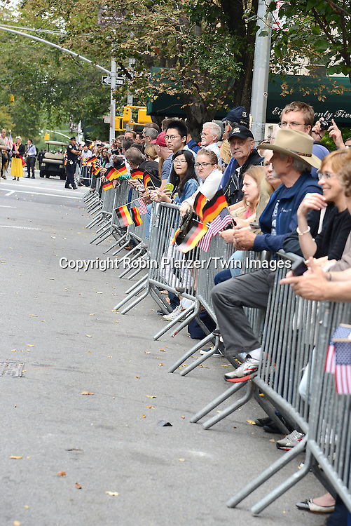 Spectators watch the Steuben Parade on Fifth Avenue in New York City on September 20. 2014.<br /> <br /> photo by Robin Platzer/Twin Images<br />  <br /> phone number 212-935-0770