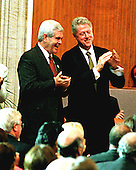 Washington, DC - September 23, 1998 -- The Speaker of the United States House of Representatives Newt Gingrich (Republican of Georgia) and United States President Bill Clinton share a light moment during South African President Nelson Mandela's speech  accepting the Congressional Gold Medal in the United States Capitol Rotunda on Wednesday, September 23, 1998...Credit: Ron Sachs / CNP