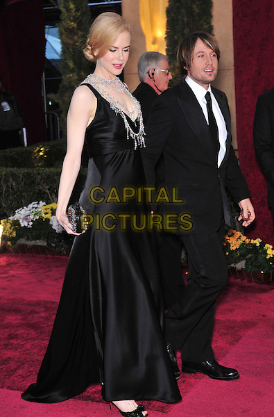 NICOLE KIDMAN & KEITH URBAN.The 80th Annual Academy Awards arrivals held at the Kodak Theatre, Hollywood, California, USA. .February 24th, 2008.oscars full length black suit dress silver chain necklaces married husband wife pregnant clutch bag purse .CAP/ADM/GB.©Gary Boas/AdMedia/Capital Pictures.