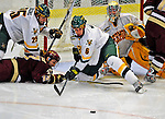 10 January 2009: University of Vermont Catamount defensemen Kyle Medvec (6), a Sophomore from Burnsville, MN, defends the net against the Boston College Eagles during the second game of a weekend series at Gutterson Fieldhouse in Burlington, Vermont. The Catamounts rallied from an early 2-0 deficit to defeat the visiting Eagles 4-2. Mandatory Photo Credit: Ed Wolfstein Photo