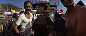 Haridwar 12.02.2010 India..The Maha (Great) Kumbh Mela in Haridwar. Pilgrims and Sadhus in great number from around India visit here to bath at the banks of the river Ganges. They belive that a holy dip in sacred river during Maha Kumbh takes human out of the circle of life and death. Pilgrims from Rajastan..photo Maciej Jeziorek/Napoimages..Haridwar 12.02.2010 Indie.Kumbh Mela ( Swieto Dzbana ). Pielgrzymi i Sadhu ( Swieci - hinduscy wedrowni asceci) przybywaja tu zanurzyc sie w Gangesie. Wierza oni, ze pozwoli im to wyrwac sie z cyklu narodzin i smierci. Pielgrzymi z Radzastanu..fot. Maciej Jeziorek/Napoimages.
