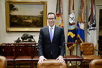 United States Secretary of the Treasury Steve Mnuchin stands behind his chair in the Roosevelt Room of the White House in Washington, DC prior to a meeting with US President Donald J. Trump to discuss the Federal budget on February 22, 2017 in Washington, DC. <br /> Credit: Olivier Douliery / Pool via CNP /MediaPunch