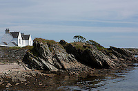 A typical example of one of the old Islay cottages, built of stone and whitewashed