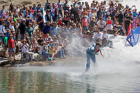 """Cushing Classic at Squaw Valley 26"" - Photograph of a skier crossing a pond during the Cushing Classic at Squaw Valley, USA."