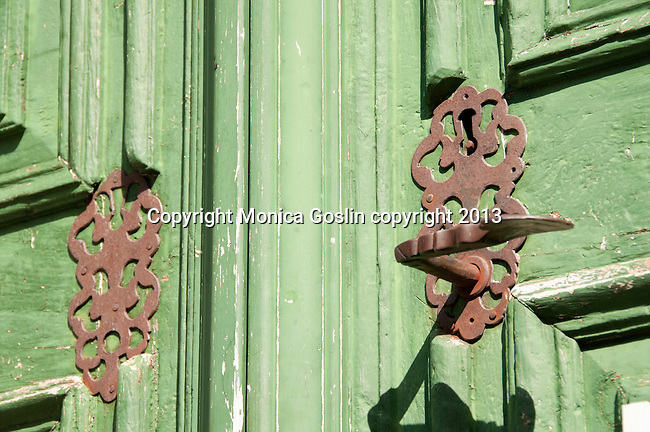 Green door and iron lock of the church in Soglio, Switzerland a town the Bregaglia Valley which dates back to 1219 and is said to be one of the most picturesque towns in Switzerland