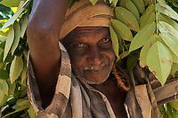 Farmer carrying his load, Sri lanka
