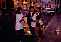 A cab driver and his girlfriend hangout with another friend on the Plaza de Armas in central Trujillo, Peru's third largest city of 750,000.  <br /> Founded in 1536 by Pizarro, the attractive colonial city has an impressive main square.  Horse and buggy rides around the plaza for tourists.