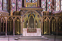 General view of the altar and the reliquary, built on the pattern of the chapel, Upper chapel of La Sainte-Chapelle ( (The Holy Chapel), 1248, Paris, France. La Sainte-Chapelle was commissioned by King Louis IX of France to house his collection of Passion Relics, including the Crown of Thorns. In the choir, the windows have only two lancets. The most famous features of the chapel are the great stained glass windows. Fifteen huge mid-13th century windows fill the nave and apse. Picture by Manuel Cohen