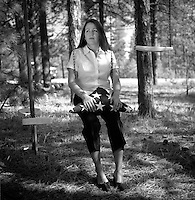 Mia Sagahon, the former finacee of Sgt. Walter Padilla, a Iraq veteran who killed himself in early April, poses with his burial flag on a swing from her childhood in Colorado Springs, Colo., Wednesday, May 9, 2007. Padilla suffered from post-traumatic stress disorder. (Kevin Moloney for the New York Times)