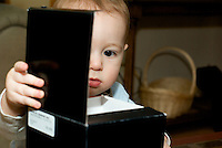 Toddler looking into a box