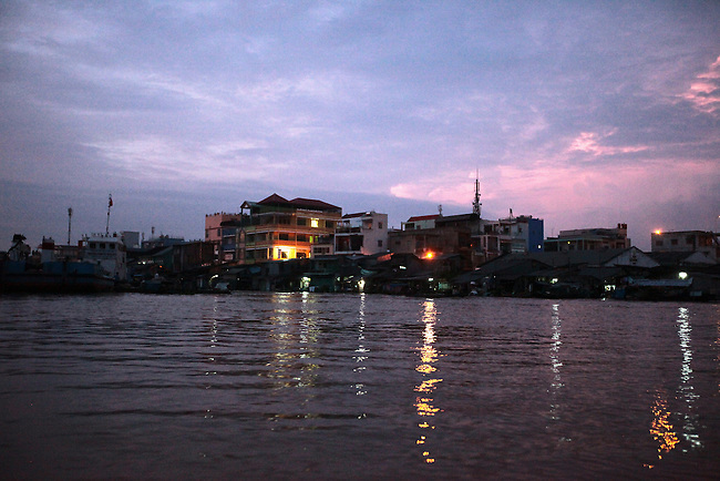 The sky is painted in shades of purple and pink as the sun rises over the Hau River in the Mekong Delta, south of Can Tho, Vietnam. Sept. 30, 2011.
