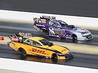 Sep 18, 2016; Concord, NC, USA; NHRA funny car driver Del Worsham (near) races alongside Jack Beckman during the Carolina Nationals at zMax Dragway. Mandatory Credit: Mark J. Rebilas-USA TODAY Sports