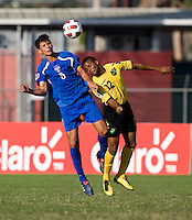 Patrick Palmer (12) of Jamaica goes up for a header with Jeffri Flores (5) of Honduras during the quarterfinals of the CONCACAF Men's Under 17 Championship at Catherine Hall Stadium in Montego Bay, Jamaica. Jamaica defeated Honduras, 2-1.