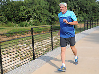NWA Democrat-Gazette/FLIP PUTTHOFF<br /> Ross HInshaw of Springdale ran and walked and all 37 miles of the Razorback Greenway in three consecutive days to celebrate his 60th birthday. He's seen here in August 2015 near downtown Springdale.