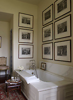 In the luxurious guest bathroom, the tub and fittings are by Waterworks, the early 19th century prints are of Napolean and Pope Pius VII, and the stool is Chinese