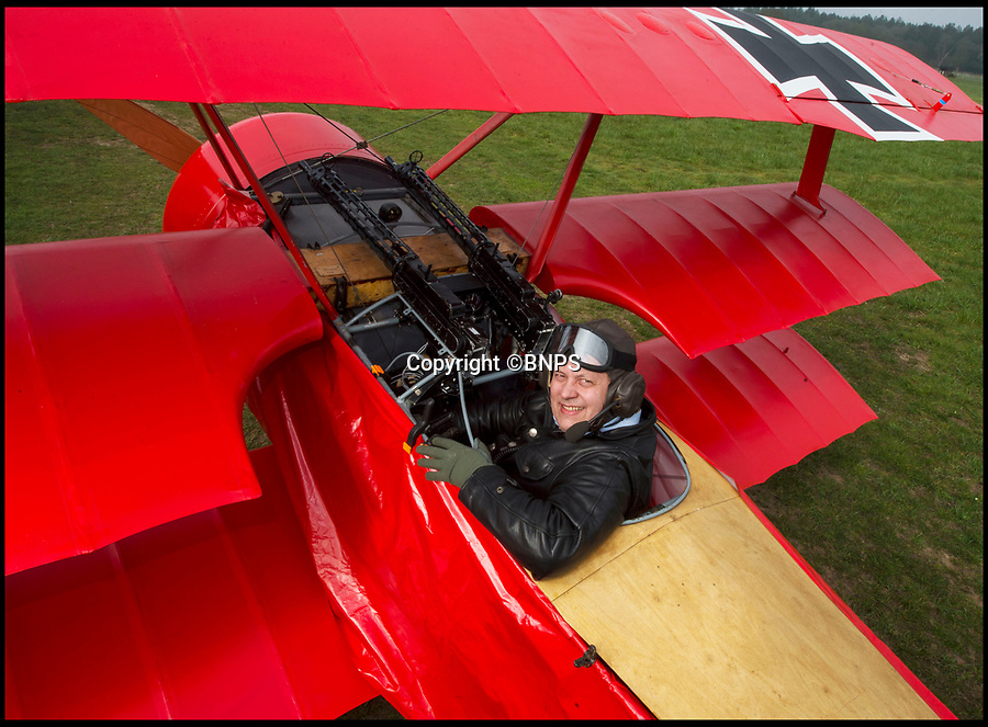 BNPS.co.uk (01202 558833)<br /> Pic: PhilYeomans/BNPS<br /> <br /> Baron Peter von Brueggemann with the Fokker Dreidecker he has built in his garage.<br /> <br />  Dreaded Red Baron to fly again...WW1 Ace's feared 'Fokker Dreidecker' to finally fly over Britain.<br /> <br /> A German GP based in Norfolk has spent 8 years building a Fokker triplane in his garage as a tribute to infamous WW1 Ace Manfred von Ricthofen, who terrorised the skies over the Western front during the first war.<br /> <br /> Dr Peter Brueggemann, 52, will fulfil his childhood dream and emulate the notorious German fighter pilot when the Dreidecker Dr.1 fighter finally achieves lift-off this summer.<br /> <br /> Dr Brueggemann has even acquired the title Baron from the independent territory of Sealand so he can take to the skies as Baron Peter von Brueggemann in homage to his idol.<br /> <br /> The GP at the Holt Medical Practice in Norfolk hopes to be airborne in a few months once tests on the engine are completed at Felthorpe airfield near Norwich where he has devoted thousands of hours to the project.<br /> <br /> The father-of-two, who has lived in England with wife Sue for 20 years, has been taking flying lessons since his project began.