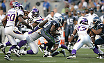 Seattle Seahawks running back Justin Forsett struggles for extra yardage while being tackled by Minnesota Vikings defensive tackle Letroy Guion (96) and cornerback Brandon Burton (36) at CenturyLink Field in Seattle, Washington August 20, 2011. The Vikings beat the Seahawks  20-7. ©2011 Jim Bryant Photo. All Rights Reserved.