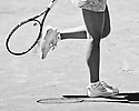 Jelena Jankovic knocks the clay off her shoes in between points during the 2011 Family Circle Cup at Daniel Island.