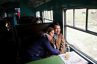 Maritza Aranda and Yerver Ruiz, a couple from Huancayo, ride in the buffet car of the Huancayo-Huancavelica train. The128 km ride between Huancayo and Huancavelica costs 12 soles, less than 5 dollars, in this specialty car.
