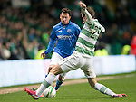 Celtic v St Johnstone.....04.03.15<br /> Danny Swanson is closed down by Stefan Johansen<br /> Picture by Graeme Hart.<br /> Copyright Perthshire Picture Agency<br /> Tel: 01738 623350  Mobile: 07990 594431