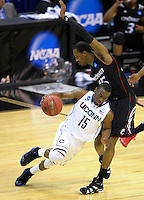 Huskies Kemba Walker leans against Bearcats' Darnell Wilks. UConn defeats Cincinnati 69-58 during the 3rd round of the NCAA Tournament at the Verizon Center in Washington, D.C on Saturday, March 19, 2011. Alan P. Santos/DC Sports Box