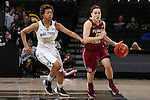 28 January 2016: Florida State's Brittany Brown (12) and Wake Forest's Ariel Stephenson (25). The Wake Forest University Demon Deacons hosted the Florida State University Seminoles at Lawrence Joel Veterans Memorial Coliseum in Winston-Salem, North Carolina in a 2015-16 NCAA Division I Women's Basketball game. Florida State won the game 96-55.