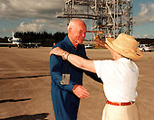 STS-95 Payload Specialist John H. Glenn Jr., United States Senator from Ohio, reaches to embrace his wife, Annie, after landing at Kennedy Space Center's Shuttle Landing Facility aboard a T-38 jet on October 26, 1998. Behind the couple is the mate/demate device used to raise and lower the orbiter from its shuttle carrier aircraft during ferry operations. Glenn and other crew members flew into KSC to make final preparations for launch. Targeted for liftoff at 2 p.m. on October 29, 1998, the STS-95 mission includes research payloads such as the Spartan solar-observing deployable spacecraft, the Hubble Space Telescope Orbital Systems Test Platform, the International Extreme Ultraviolet Hitchhiker, as well as the SPACEHAB single module with experiments on space flight and the aging process. The mission is expected to last 8 days, 21 hours and 49 minutes, and return to KSC on November 7, 1998..Credit: NASA via CNP