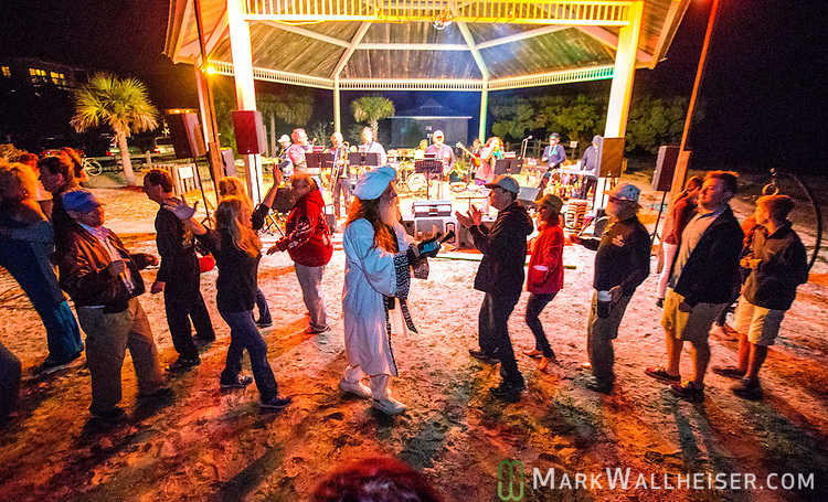 Swami leads the conga line as the Festoons play at the 2017 Wind Ceremony at Shell Point Beach in the Wakulla County panhandle of Florida put on by the Shell Point Sailboard Club.