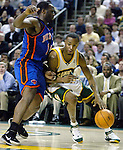Seattle SuperSonics Rashard Lewis, right,  dribbles past New York Knicks Malik Rosa during the first half of their game at Key Arena in Seattle, Washington Friday, 25 March 2005. Jim Bryant Photo. &copy;2010. All Rights Reserved.