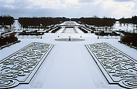 A view from the 17th century Chateau du Champ de Bataille over the grand snow-covered gardens and park