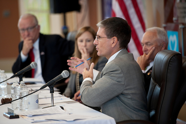 UNITED STATES - AUGUST 30: Rep. Joe Heck, R-Nev., questions witnesses as House Education and Workforce Committee chairman John Kline, R-Minn., right, and House Armed Services Committee chairman Buck McKeon, R-Calif., left, listen during the House Education and Workforce Committee field hearing on Local Ideas to Reform Federal Job Training Programs on Tuesday, Aug. 30, 2011. The hearing was held in Heck's Las Vegas district at Opportunity Village, a not-for-profit organization that provides people with intellectual disabilities with vocational training. (Photo By Bill Clark/Roll Call)