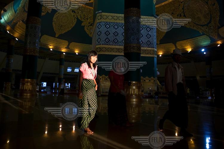 Visitors walk through the interior of the replica Shwedagon Pagoda in Naypyitaw, the new capital of Burma (Myanmar) since November 2005.