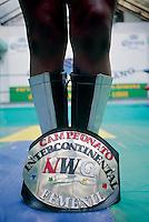 "Tania la Guerillers shows off her championship belt ""International Women's Championship"" Gimnasio Latinoamericano.  Mexico City, June 2004"