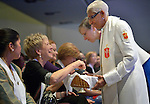 United Methodist Bishop Violet Fisher serves communion to newly consecrated Deaconess  Barbara L. Haralson at the United Methodist Women's Assembly during an April 27, 2014 worship service at the Kentucky International Convention Center in Louisville, Kentucky.