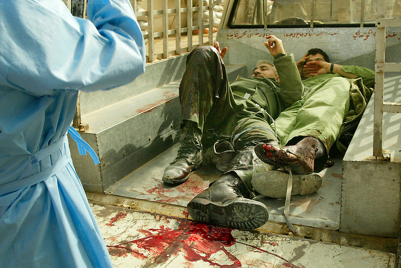 Baghdad, Iraq, April 5, 2003.Wounded Iraqi soldiers rushed to Al Kindi hospital on the back of a pick-up truck. More than 70 US bombardment victims were admitted in less than 2 hours after a B52 carpet bombing on the Northern outskirts, about a fifth of these were military personel.