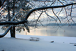 A snow covered picnic table on the beach of lake Coeur D Alene, Idaho
