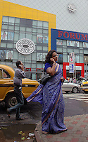 Indian people using mobile phone in front of Shoppers' Stop in Kolkata, India  Arindam Mukherjee