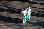 Kimono-clad 20-year-old Japanese women look at photos on a camera monitor during an event to mark Coming-of-Age Day at Toshimaen amusement park in Tokyo, Japan on Monday Jan. 11, 2009. Japanese enter adulthood at 20, when they can legally smoke, drink alcohol and vote, though debate is heating up as to whether or not the age should be lowered to 18 in line with many advanced countries. Indeed, the Japanese government plans to lower the voting age to 18 as of mid-2010.   .Photographer: Robert GilhoolyCOMING OF AGE