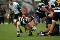Adam Deck passes from a ruck during the Swindale Shield Wellington premier club rugby match between Oriental-Rongotai and Old Boys-University at Polo Ground in Wellington, New Zealand on Saturday, 29 April 2017. Photo: Dave Lintott / lintottphoto.co.nz