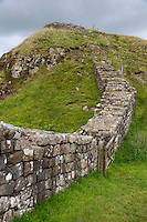 Northumberland,  England, UK.  Hadrian's Wall Rising up Winshield Crags.