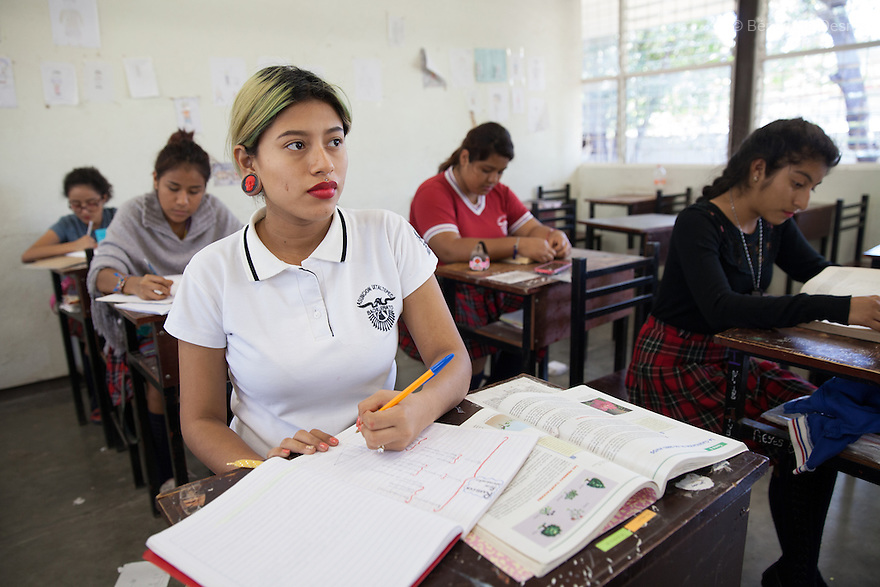 Xochiquetzal S&aacute;nchez Escobar at school in Juchit&aacute;n, Mexico on February 18, 2016. Despite her teenage rebel style, Xochi, as she is known, dressed in the traditional Zapotec style for her engagement party. She is 17 and five months pregnant. The daughter of a single-mother former missionary and nun, Xochi says she had always talked about having a baby in her teens because she thought her mother was old when she had her at 28. She kept her pregnancy secret from her mother until February. After the baby - a boy, David Mateo - is born in June, she plans to move with her boyfriend to a house where they will live together and he will have his tattoo studio, and they plan to marry next June. She plans to finish her final year of secondary school in the town of El Espinal in the southern Mexican state of Oaxaca next year, with her mother looking after the baby in the mornings while she is in class. Being a schoolgirl housewife does not worry her, she says, although she admits she cannot cook. Her grandmother, who lives with the family, is thrilled at the prospect of a great-grandchild. Xochi dreams of giving birth in water, but is not sure that will happen. While Mexico has outlawed marriage under the age of 18, many young girls become unofficial wives and mothers much earlier. In Juchit&aacute;n, teenage pregnancy is expected, even prized. Mexico ranks first in teenage pregnancies among the member countries of the Organization for Economic Co-operation and Development&nbsp;(OECD). Photo by B&eacute;n&eacute;dicte Desrus<br /> &nbsp;